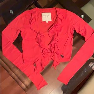 coral open cardigan with ruffles down the middle